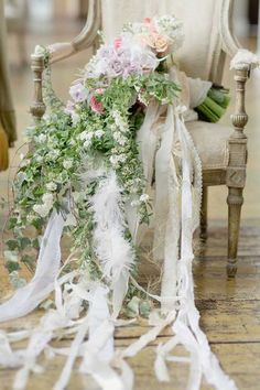 Love the long cloth ribbons hanging down from the hand tied bouquet