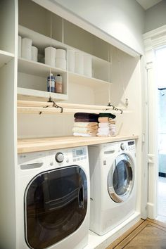 Clean white contemporary laundry room via Remodelista