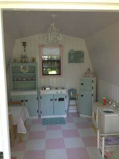 Cottage Playhouse- The chandelier is new. The wooden kitchen appliances have been repainted. Paneling and sheetrock have been added. Floor has been repainted as it once was. Playhouse, cottage