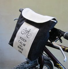 Bike Handlebar Bag/ Purse - Keep Calm and Bike On, Denim Bicycle Carrier Bag - Bike Accesories - Bike Basket - Bike Saddle Bag. $39.00, via Etsy.