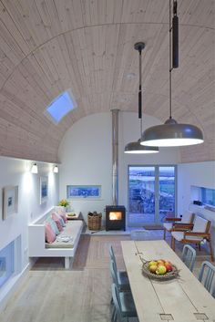 Neat interior Modern Curved Roof House with Cottage Like Addition in Scotland