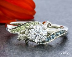 #Aquamarine and #Peridot waves surround a round diamond... Minus the turtle! #GreenLakeJewelry