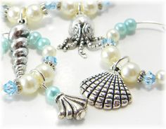 Crystal Wine Charms Seashell and Sealife Wine Rings Aqua Blue Set of 6. $14.00, via Etsy.