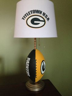 Hey, I found this really awesome Etsy listing at https://www.etsy.com/listing/200282538/green-bay-packers-football-lamp