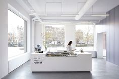Rocycle by XML | Yellowtrace. white interior, exposed white ceiling
