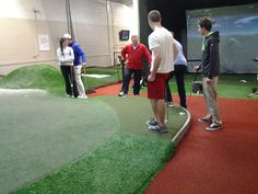 Having golf fun at indoor golf teaching facility, The Golf Practice, Highland Park, IL installed by Krevitz Golf Turf Solutions.