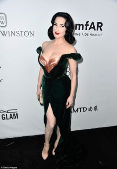 Raven haired beauty: Dita looked incredible in the sizzling gown which made the most of he...