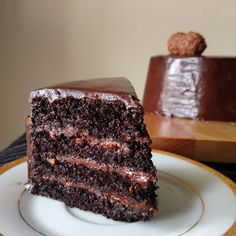 Dark and dense chocolate cake layers , filled with Nutella ganache and crushed Ferrero Rochers!