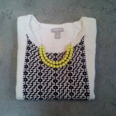 Banana Republic White Sweater with Black Print Banana Republic, size large, in great condition! White sweater with block of black and white print in center. Please ask any and all questions before purchasing. No trades. Make a reasonable offer. Thanks! Banana Republic Sweaters Crew & Scoop Necks