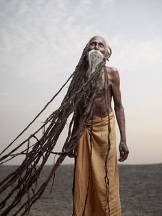 "India | ""Holy men"" photo series from Varanasi.  ""Lal Baba has dreadlocks several meters long, which have been growing for over 40 years. To sadhus, dreadlocks are a sign of renunciation and a life dedicated to spirituality."" 