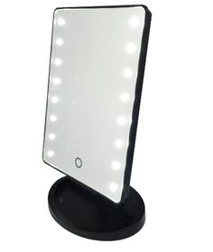 This adorable mini vanity mirror features a touch screen, LED lights, and a removable magnified mirror. Compact, easy to travel with, and fits perfect on your b