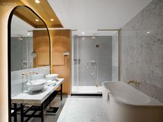 Feels elegant but still retains use of natural warm wood. Like the black and white stripes feature in the shower.