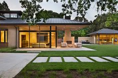 Harmony With Nature in Silicon Valley  Designed by Timothy Chappelle - glass-clad corridors that connect the hipped-roof building forms