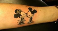 Mickey and Minnie mouse tattoo.