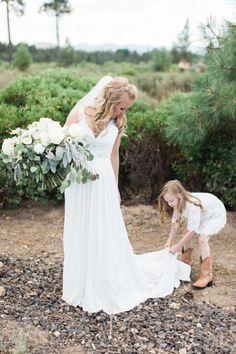 Adorable bride's little helper: http://www.stylemepretty.com/oregon-weddings/bend/2016/01/26/whimsical-elegant-oregon-ranch-wedding/ | Photography: Ivy And Gold - http://www.ivyandgold.com/