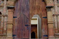 A gorgeous wooden door, leading up to a patio before the town church entrance in Curiti, Santander.