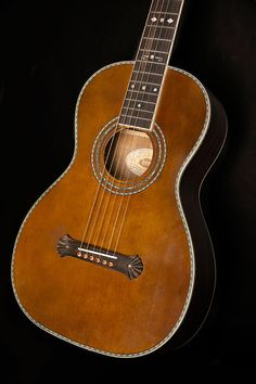 Washburn Vintage series acoustic Parlor with spruce top, trembesi back/sides, V shaped neck with ebony fretboard and vintage matte finish, includes case