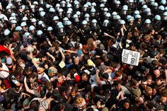 Police hold back protesters at nato summit.