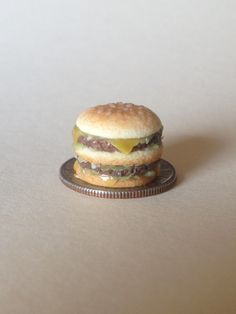 Miniature polymer clay cheeseburger by Megan Hess