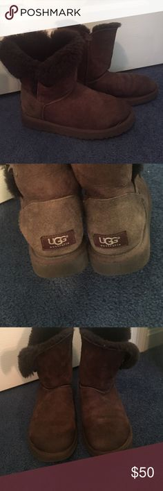 Chocolate brown bailey button Uggs Chocolate brown, bailey button, uggs boots in a size 7. Definitely worn but still in decent condition. Toes are a little darker (snow stains) and sides with buttons are rolling down at flaps. UGG Shoes Winter & Rain Boots