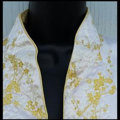 Dramatic, 1960s extra large, reversible evening or cocktail coat. Gold on one side; white on the other.  Lavish quilting, amazing details and perfect