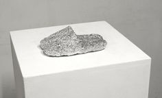 Untitled (Siamese Slippers), 2015, plinth, aluminum foil, 112x40x40 cm