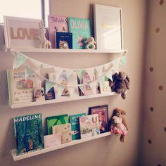Spice shelves as book shelves. Gold prints.