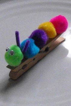 In this fun preschool arts and crafts activity, your child will create a cute and colorful caterpillar using pom poms, googly eyes, and a clothespin.