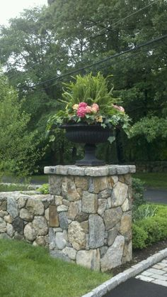 -Ferns, ivy & hydrangea in a Cast Iron Urn on stone wall column makes a beautiful entrance to a yard or garden