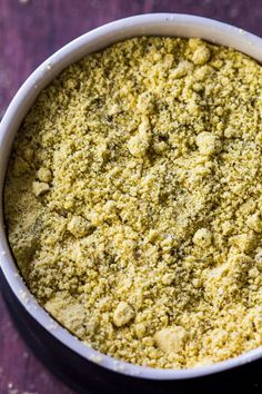 Vegan Parmesan with 4 ingredients ready in than 5 minutes. I always have some of this cheesy parmesan on hand to sprinkle on pasta, potatoes & casseroles.
