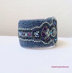 Bead embroidered cuff bracelet with paua abalone cabochons in