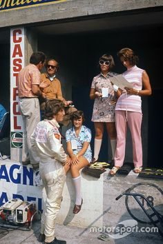Jochen Rindt (Lotus during practice before his fatal accident. Colin Chapman talks in the pits whilst Rindt is in conversation with Hazel Chapman and her two daughters, Monza, Italy. Ford, Grand Prix, F1 Motor, Jochen Rindt, Lotus F1, 5th September, The Right Stuff, F1 Drivers, Two Daughters