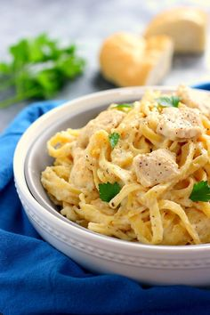 This One Pan Chicken Fettuccine Alfredo is filled with tender chicken and fresh pasta thats tossed in a lightened, creamy sauce.