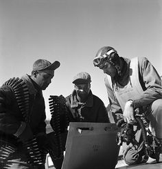 Tuskegee Airment Roscoe Brown, Marcellus Smith and Benjamin Davis, with ammunition at Ramitelli Airfield in Italy. Photograph by Toni Frissell, March 1945.