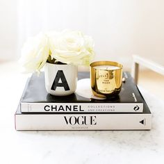 coffee table / fashion books / candle / flowers