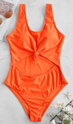 52177494b Make a statement in this one-piece neon swimsuit. The large cutout at the