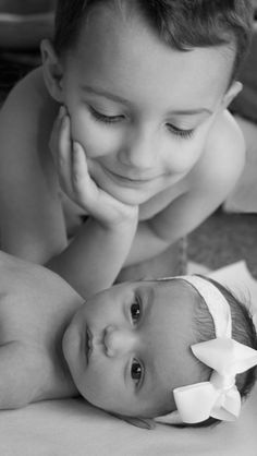 In LOVE with this picture! LOVE LOVE LOVE. so sweet and loving..big brother is gunna take care of little sister :)