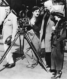 Charlie Chaplin showing Mary Pickford and guest how a motion picture camera works