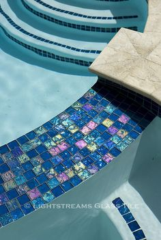 American made Lightstreams Peacock Blue iridescent glasstiles are in this San Francisco Bay Area pool as waterline tile, spa tile, pool step tile, spillway tile, and wall tile. Lightstreams gold glass tiles accent the pool steps and wall tile. Swimming Pool Tiles, Swimming Pools Backyard, Garden Pool, Glass Pool Tile, Iridescent Tile, Tile Stairs, Glass Fire Pit, Pool Steps, Pool Remodel
