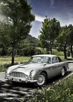 The Aston Martin is one of the most elegant grand tourer supercars available. Available in a couple or convertible The Aston Martin has it all. Aston Martin Db5, Classic Sports Cars, Saturn Sky, Classy Cars, Sexy Cars, Range Rover Sport 2017, Vintage Cars, Antique Cars, Singer Porsche