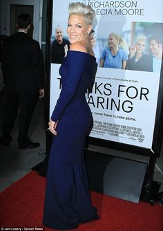 P!nk :The 34-year-old pop star covered her muscular, tattooed figure in an off-the-shoulder cobalt blue gown at Hollywood premiere Monday