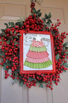 One thing you may find all over my blog is WREATHS.I'm kinda addicted!I DID NOT like my Christmas Wreath from last year so I decided to make a new one this year.I loved my Valentine's Wreath so much that I decided to do something similar for Christmas and made this Christmas Wreath Tutorial for you.Do you like it??I totally copied my own creation from earlier this year and then also found the inspiration for the Tree HERE {so cute!}If you would like to make one too, here is what you'll