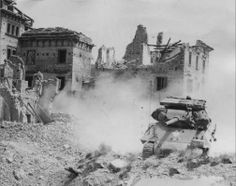 US Fifth Army M10 Tank Destroyer of the 3rd Algerian Division plows through the outskirts of Ausonia, Italy, 15 May 1944.