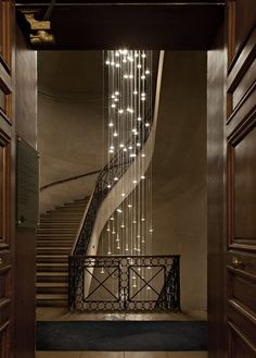If you are fortunate enough to have a stairway like this, an exaggerated light can really add to the scale of the space.