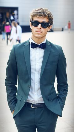 Teal is a really cool suit color, even cooler when you match it with a midnight blue velvet bow tie. We dare you.