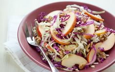 A colorful, simple and absolutely delicious slaw for any season. You can shred the cabbage on the large holes of a box grater, with the shredding attachment of a food processor or by simply slicing it very finely with a sharp knife. Before shredding, you may want to first quarter the cabbage heads and use a paring knife to cut around and remove the white core at the center of the heads; it's denser in texture and has a slightly more bitter flavor than the leafy part of the cabbage.