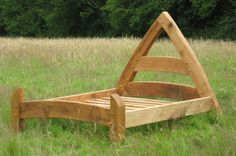 cool bed shaped like a cruck. I wish I knew how to build this!!