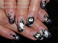 @pelikh_Nails with cats halloween nails