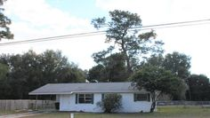 Handyman special. Block home in good condition.  Needs cosmetic improvements. Large fenced yard. Terrazo and tiled flooring. Enclosed lanai and separate laundry room. HVAC updated in 2011.Roof is approx 13 yrs old. New windows have been ordered and will be installed. Freshly painted. Immediate occupancy.