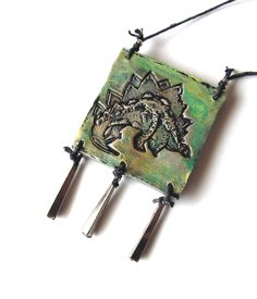 Pendant Necklace Dinosaur Stegosaurus Sauropod Stamp Impression in Clay Green Gold Silver Patina Vintage Upcycled Dangles on Hemp Cord by VanessaStoryDesigns on Etsy